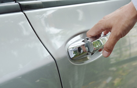 car door handle opened by hand down and pulling 版權商用圖片