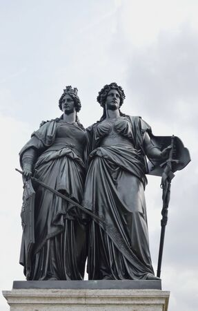 Geneva Switzerland June 3, 2014 : national monument with two women each carrying a sword and shield symbolic republic of Geneva and Helvetia for unified Swiss confederation on September 12, 1814
