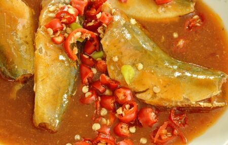 sardine can: mackerel in ketchup can food topping slice chili on dish