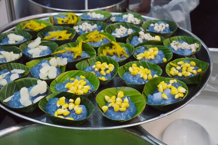 sugar palm: taro corn palm pumpkin and millet prepare for stuffed in pudding with coconut topping on banana leaf
