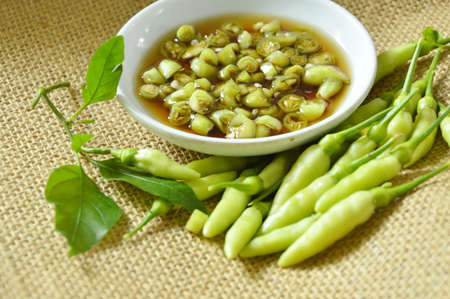 padi: fresh green chili cutting and mixed in fish sauce on cup