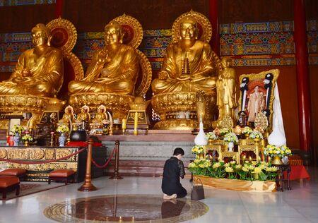 Bangkok Thailand October 14, 2017 : Thai woman pay respect to image of the late king Bhumibol Adulyadej in Leng Nei Yi 2 or Barom Racha Kajanapisek Anusorn Canasongjennigairangsan Chinese temple