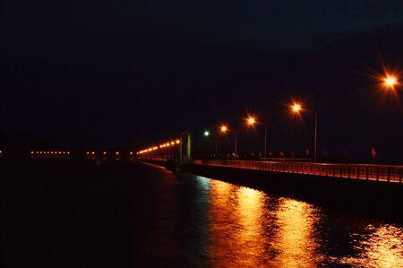 Khun Dan Prakarn Chon big concrete dam in Thailand on night