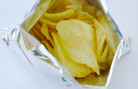potato chip in aluminium foil packaging on white background