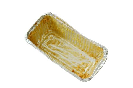 stain of butter cake in empty aluminum tray on white background