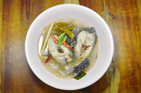boiled snake head fish in hot and spicy tom yum soup on bowl