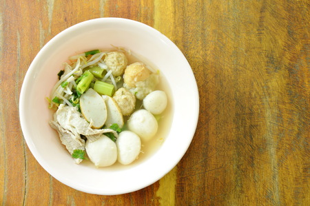 boiled fish and shrimp ball topping slice pork in clear soup on bowl 스톡 콘텐츠