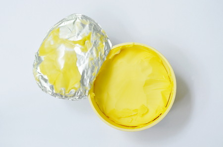 margarine in box packaging on white background