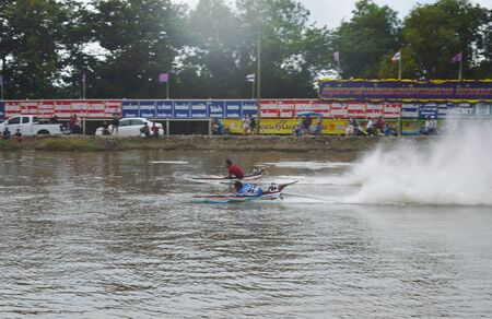 Nakornnayok Thailand September 23, 2018 : speed wooden long tail boat with engine modify racing on Rangsit-Nakornnayok canal in Thailand