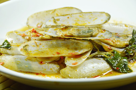 stir fried razor clams with roasted chili paste on plate