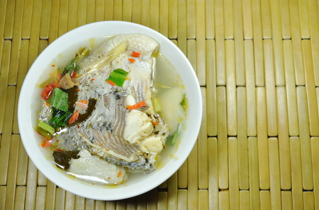 spicy boiled Tilapia fish in tom yum soup on bowl