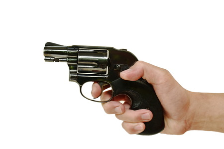 hand holding revolver gun and finger on trigger prepare to shoot in white background Stock Photo