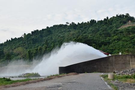 water splashing from floodgate Khun Dan Prakarn Chon huge concrete dam in Thailand