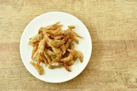 crispy fried anchovy fish with salt on plate
