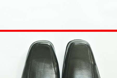 black business leather shoe with red line to transcend on white background