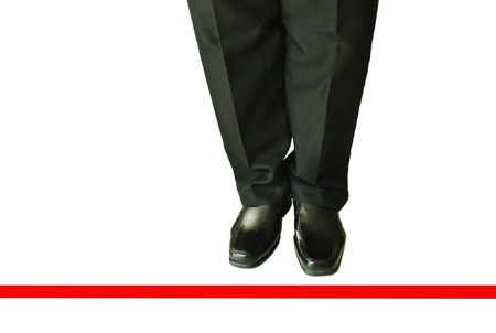 man in black business pant and lather shoe with red line to transcend on white background 写真素材