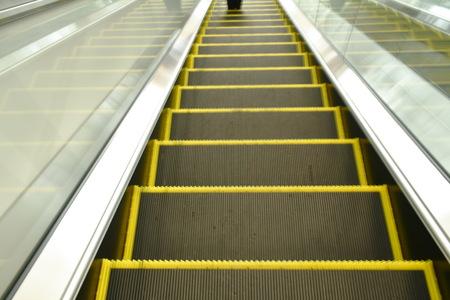 escalator down to lower floor in building