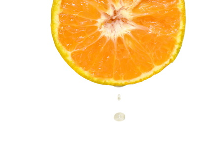 water dropping on tangerine orange half cut in white background
