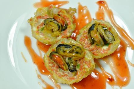 Thai sweetmeat grilled mussel coconut cream hotcake called Kanom Krok