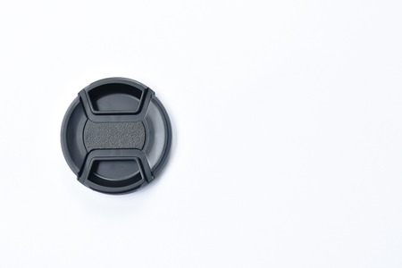 black camera lens cap for protection on white background