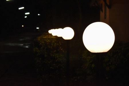 electric lamp post on street in night