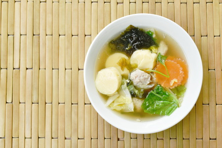 boiled egg tofu with minced pork and cabbage topping seaweed soup on bowl