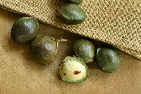 Djenkol bean or luk nieng fruit tropical plant on wooden board