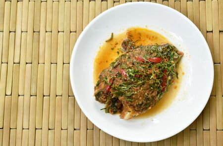 batter fried mango fish dressing spicy herb sauce on plate 写真素材