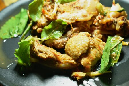 spicy fried roasted duck meat with basil leaf and finger root curry on plate