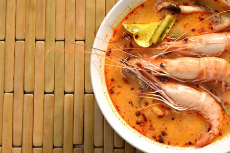 boiled shrimp with herb in Thai spicy soup or tom yum kung on bowl Stock Photo