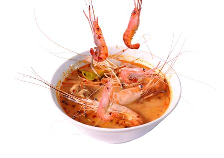 boiled shrimp falling in Thai spicy soup or tom yum kung on bowl