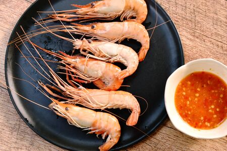 steamed shrimp with salt on dish dipping spicy sauce