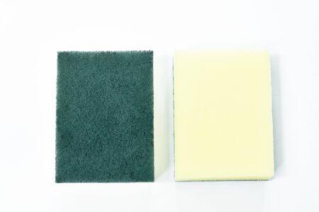 yellow and green scrub sponge wash on white background Stock Photo