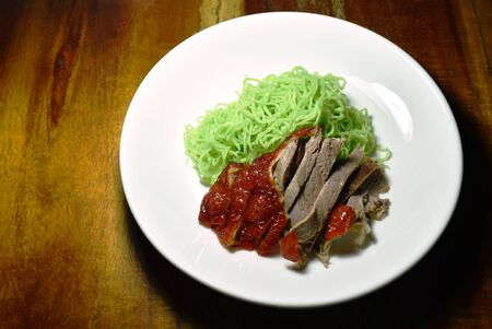 Chinese jade noodles topping slice roasted duck on plate