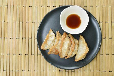 deep fried Gyoza or Japanese dumpling stuffed minced pork dipping sauce on plate Stock Photo