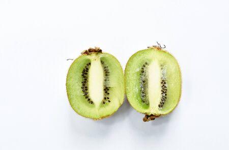 fresh kiwi fruit half cut on white background