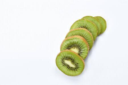 slice fresh kiwi fruit arranging on white background