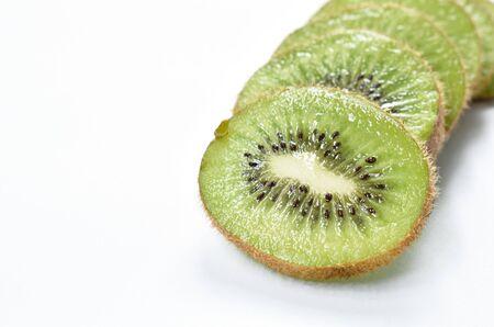 fresh kiwi fruit slice arranging on white background
