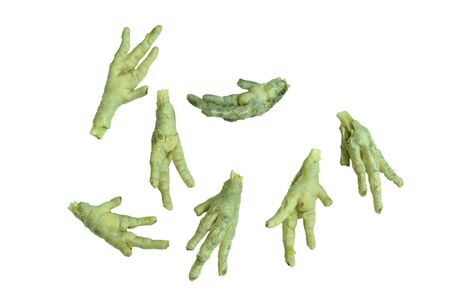 boiled chicken feet arranging on white background
