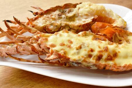 grilled lobster shrimp with cheese and butter garlic on plate Stock fotó