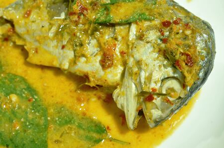 boiled mackerel in red curry on dish