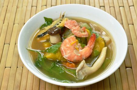 boiled spicy mixed vegetable with shrimp and smoked dry fish soup on bowl Stock fotó