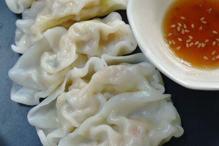 steamed Gyoza or Japanese dumpling stuffed minced pork dipping shoyu sauce on plate Stock fotó