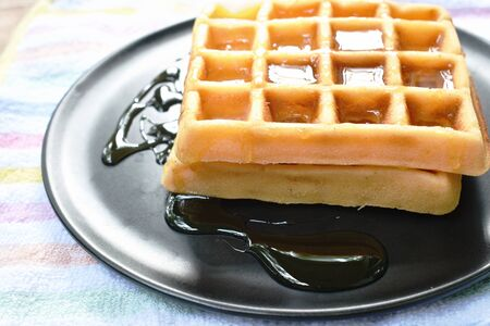 baked butter waffle dressing honey syrup on plate