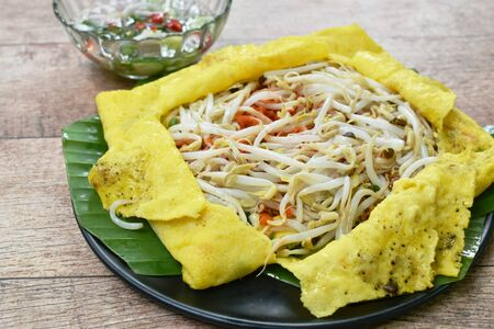 Vietnamese omelette stuffed fried bean sprout and tofu on plate dipping sweet sauce