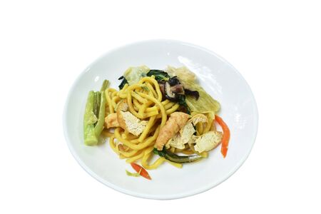stir fried yellow noodles with cabbage and tofu vegetarian food on dish