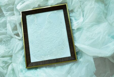 wooden picture frame on white plastic bag packing stacking Stock Photo