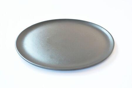 black ceramic plate on white background Stok Fotoğraf