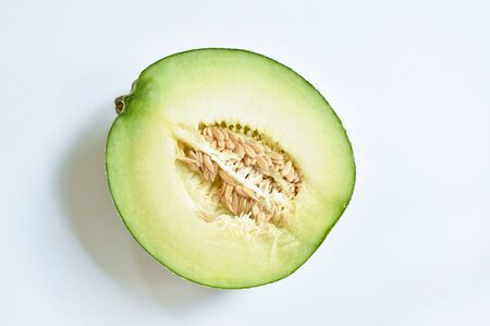 Japanese green melon half cutting on white background