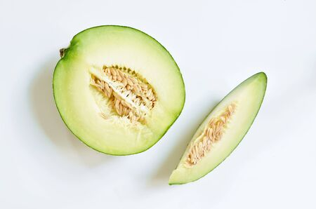 Japanese green melon cutting for piece on white background